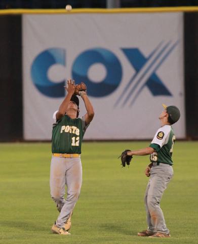 Rancho's Juan Cruz-Sanchez (12) a popup as teammate Braulio Santiaguin (15) looks on d ...