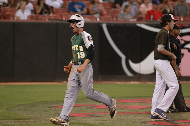 Rancho player Richard Coughlin (19) celebrates after scoring a run against Bishop Gorman dur ...