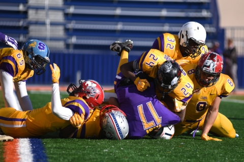 The Sunrise Region defense sacks Sunset quarterback Christian Tasi (17) during the Lions Clu ...