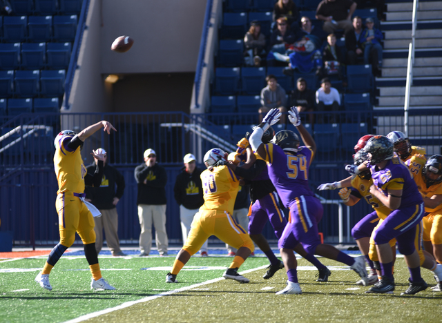 Sunrise Region quarterback Christian Lopez (15) throws a pass in Saturday's Lions Club ...