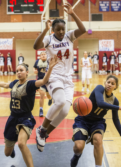Liberty's Dre'una Edwards (44) fights for a loose ball with Spring Valley' ...