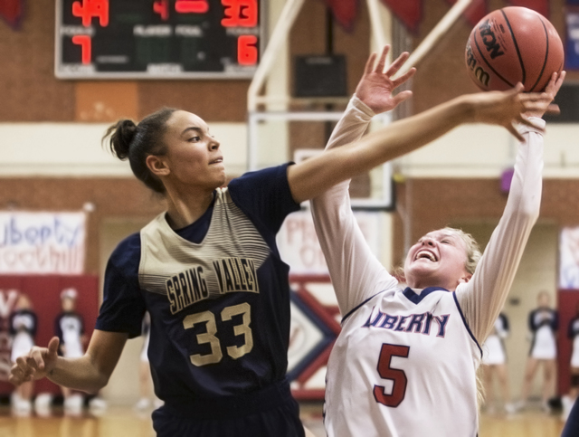 Liberty's London Pavlica (5) drives to the basket over Spring Valley's Alexus Qu ...