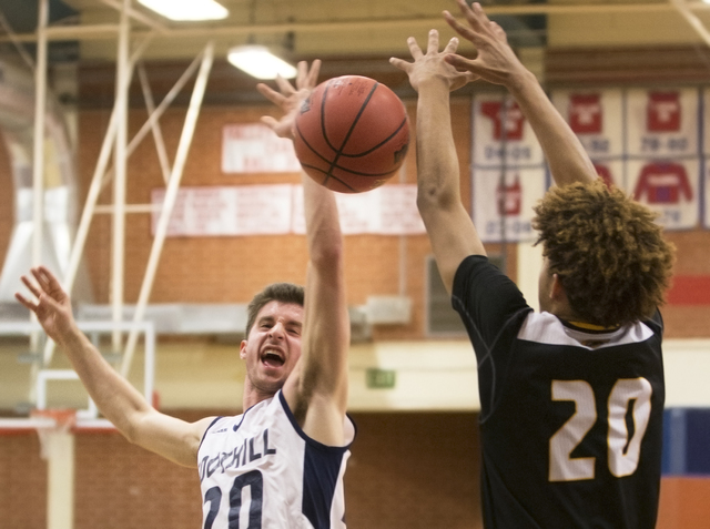 Foothill's Jeron Bodin (20) gets fouled on the way to the basket by Clark's Adam ...