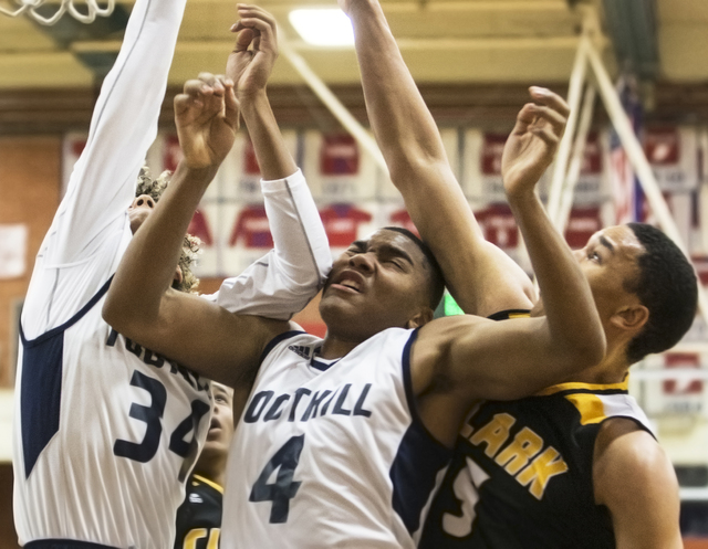 Foothill's Mauricio Smith (4) collides with teammate Carl Fischer (34) and Clark&#8217 ...