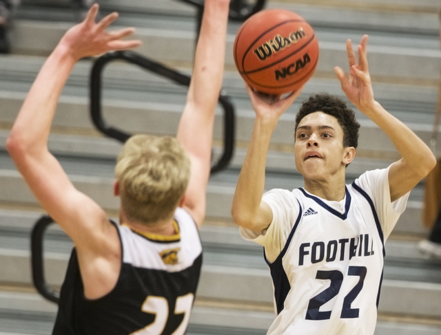 Foothill's Jace Roquemore (22) shoots a contested three point shot over Clark's ...
