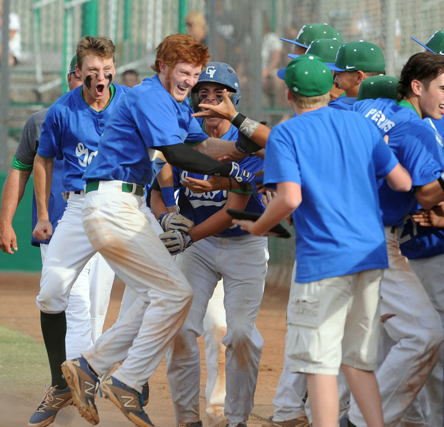 Green Valley's Keaton Smith, red hair, celebrates with his teammates after he hit a ga ...