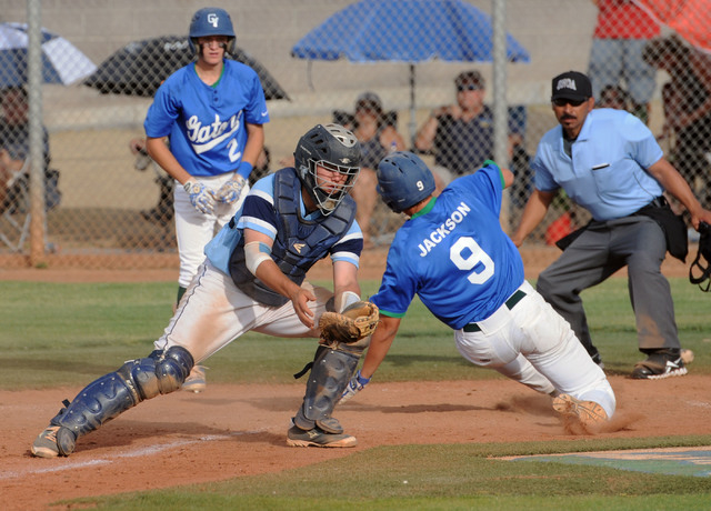 Green Valley's Ryan Jackson (9) scores the go-ahead run as Foothill catcher Zach Avery ...