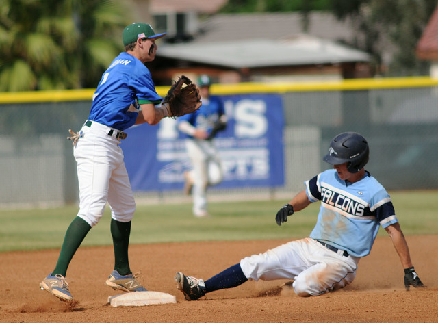 Foothill's Ryan Moyes slides safely into second base as Green Valley's Jarod Pen ...