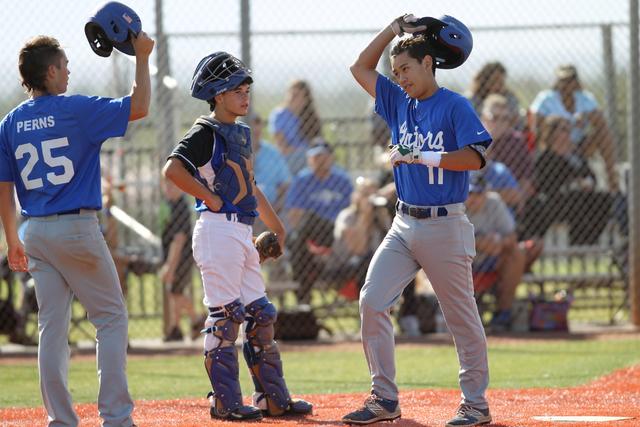 Green Valley's Blake Inouye (11) raises his helmet in celebration of his home run with ...