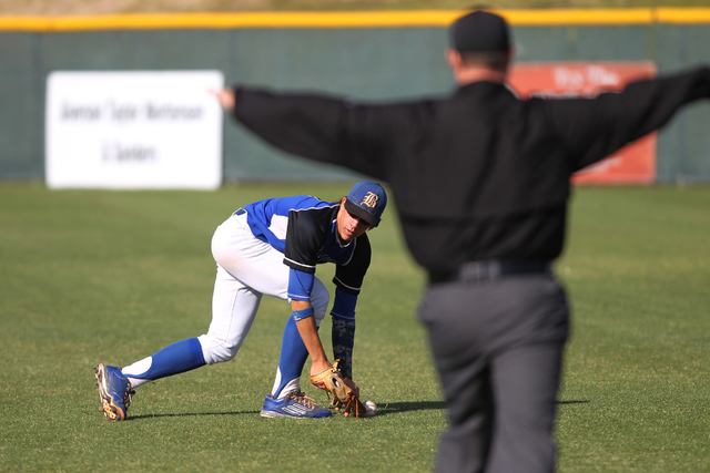 Basic's Cory Wills (2) drops a fly ball in the outfield in the second inning of their ...
