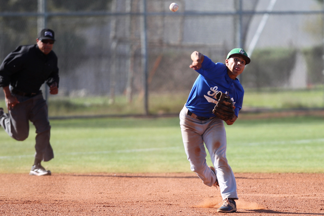 Green Valley's Jimmy Montiel (6) throws the ball to first base for an out in the secon ...