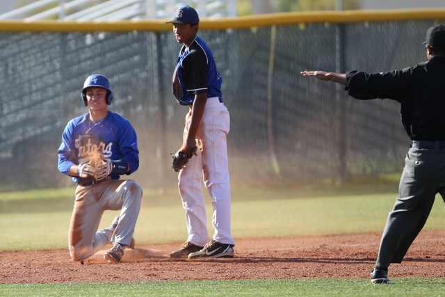 Green Valley's Gavin Morley (10) beats a tag by Basic's Garrett Giles (17) for a ...