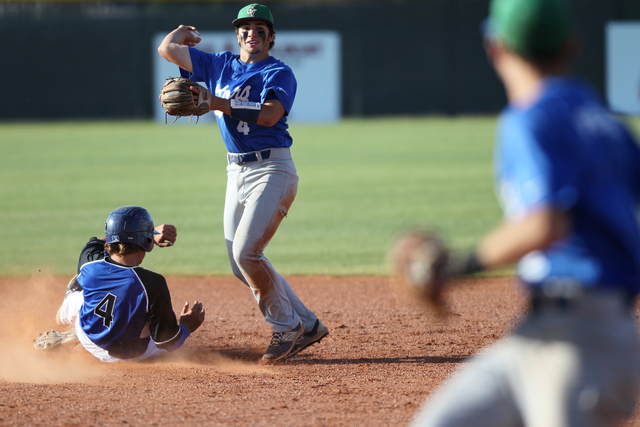 Green Valley's A.J. Amelburu (4) tags out Basic's David Hudleson (5) at second b ...