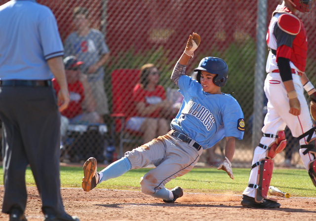 Centennial's Tanner Wright slides safely into home against Arbor View during the Sunse ...