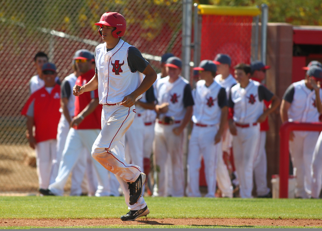 Arbor View's Kaid Urban heads for home plate after his home run against Centennial in ...