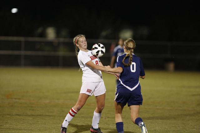 Arbor View's Breanna Larkin (8) settles the ball as Shadow Ridge's Joey Wright ( ...