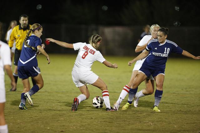 Arbor View's Breanna Larkin (8) controls the ball between Shadow Ridge's Sasha V ...