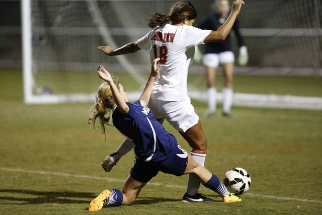 Shadow Ridge's Lindsay Irwin (4) reaches to try to poke the ball away from Arbor View& ...