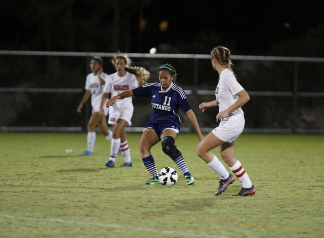 Shadow Ridge's Crystal Adame (11) moves the ball down the field during the Sunset Regi ...