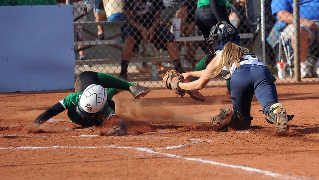 Rancho's Jahnae Davis-Houston, left, slides around the tag of Foothill catcher Hannah ...