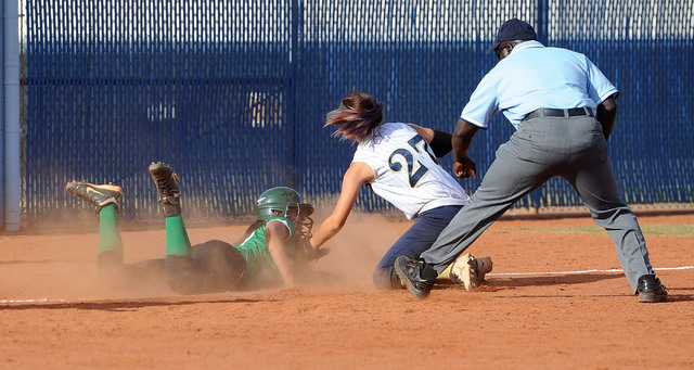Rancho's Kayla Coles, left, slides in under the tag of Foothill's Katelyn Enzwei ...