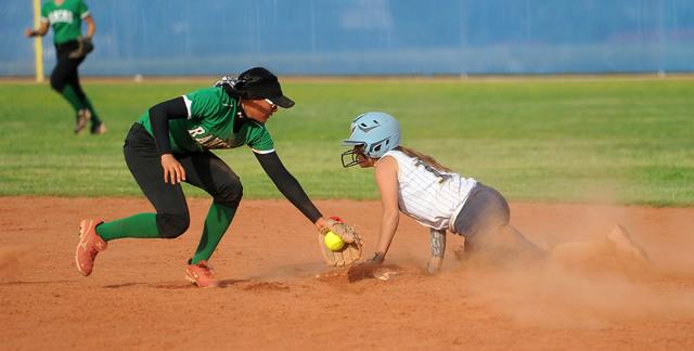Foothill's Jordan Corn slides into second with a stolen base as Rancho shortstop Tiare ...