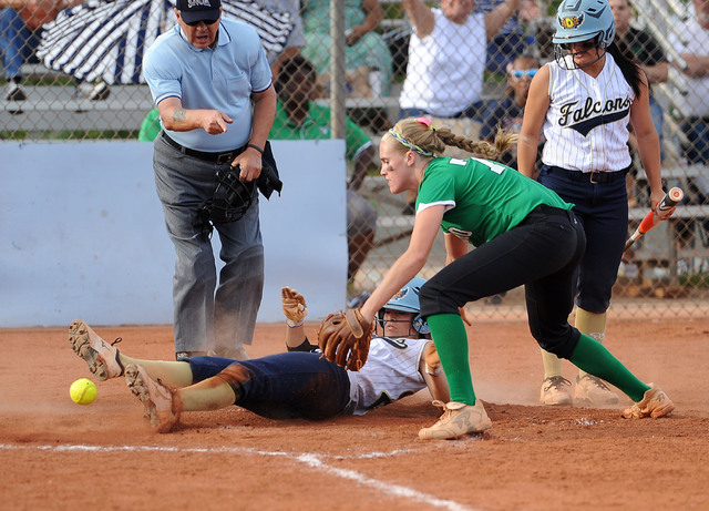 Rancho pitcher Samantha Pochop, right, drops the ball, allowing Foothill's Katelyn Enz ...