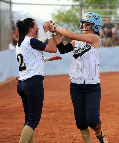 Foothill's RaeAnn Brems (2) congratulates teammate Katelyn Enzweiller after she scored ...