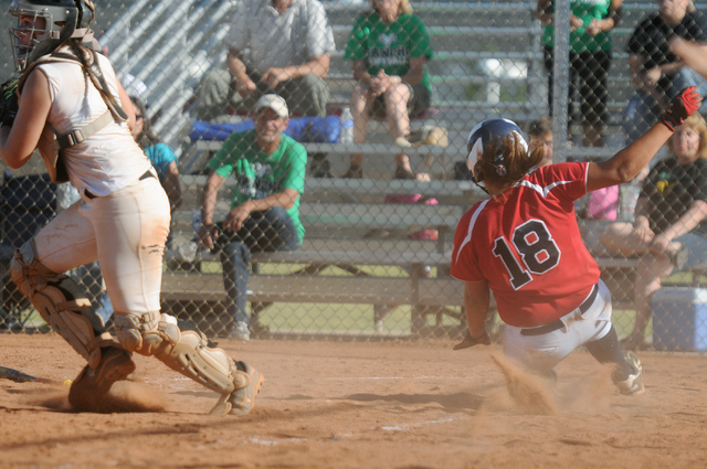 Coronado's Jillian James (18) slides home for a run against Rancho in the Sunrise Regi ...