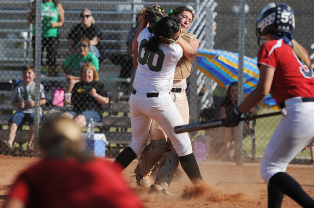 Rancho's Kayla Coles (00) collides with her teammate McKinzi Vega (1) as she makes a c ...