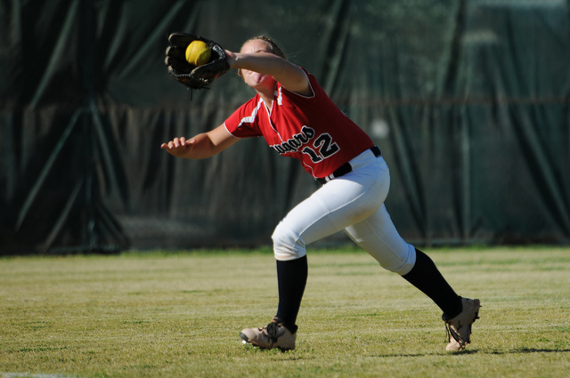 Coronado's Brooke Younie (12) makes a catch in the outfield against Rancho in the Sunr ...