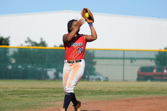Coronado's Jaiden Johnson (14) makes a catch in the infield for an out against Rancho ...