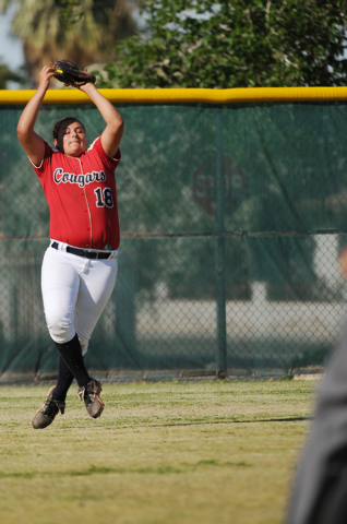 Coronado's Jillian James (18) jumps to make a catch in the outfield on Wednesday again ...