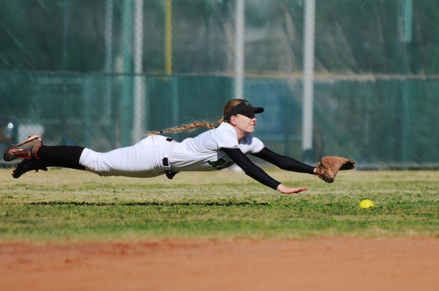 Rancho's Sam Megan Sloan (7) can't come up with a diving catch against Coronado ...