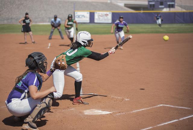 Rancho's Jahnae Davis-Houston (10) throws down a bunt against Silverado during the fir ...
