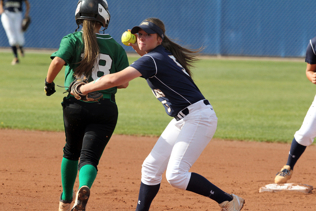 Shadow Ridge sophomore Samantha Milanovich throws to first base after tagging out baserunner ...
