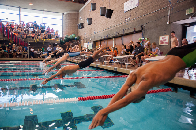 The boys dive in for the start of the 200-yard freestyle race at the Sunset Region meet on S ...
