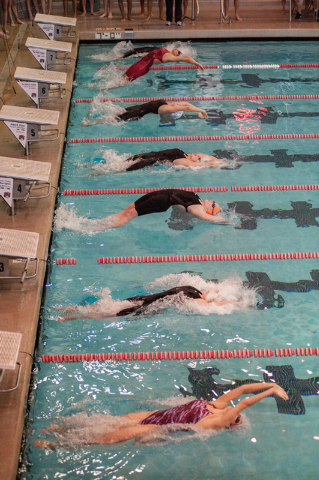 The girls dive in for the start of the 200-yard medley relay race at the Sunset Region meet ...