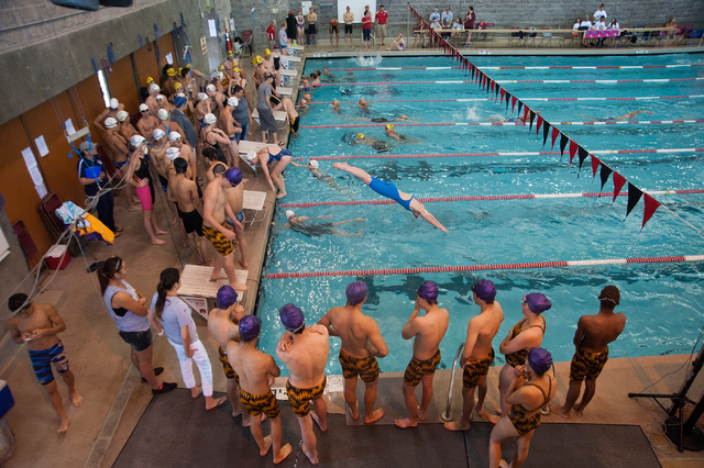 Racers warm up for the start of the Sunset Region meet on Saturday at UNLV. (Martin S. Fuent ...