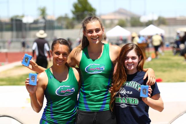 Green Valley pole vaulters, from left, McKenzie Gravo, Rachel Buck, and Sydney Eastwood, who ...