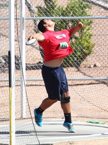 Liberty's Reno Tu'ufuli competes in the Sunrise Region boys discus on Saturday. ...
