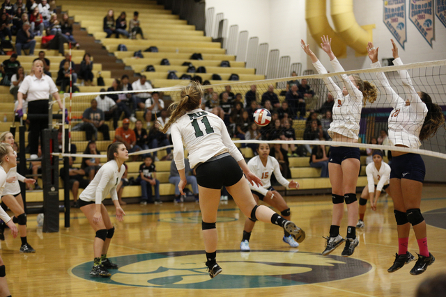 Palo Verde's kendall Cheval (11) hits the ball past Legacy's Hannah Bennet (9) a ...