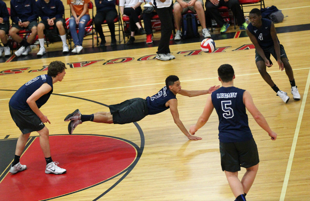 Legacy's Anthony Madden (7) dives to make a dig as Trent Compton (8), Braden Liu (5) a ...