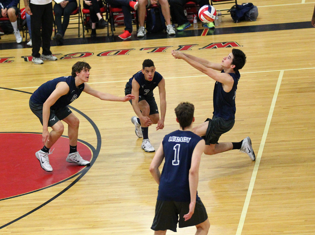 Legacy's Jonah Tarlton, right, receives the ball from Arbor View as, from left, Trent ...