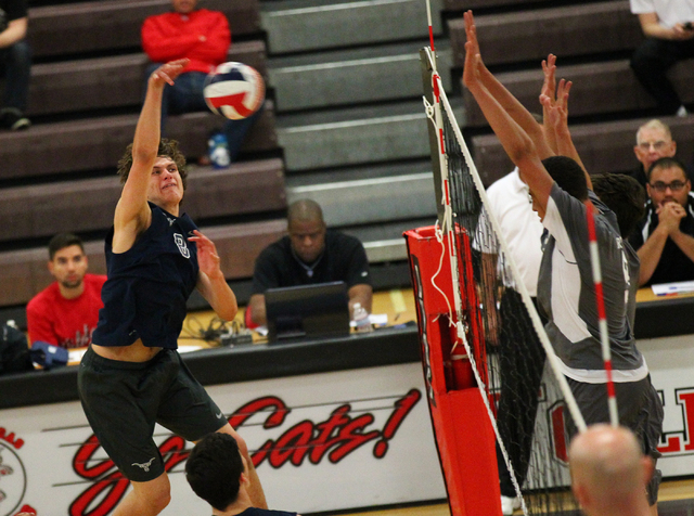Legacy's Trent Compton goes for a kill against Arbor View during a Sunset Region boys ...