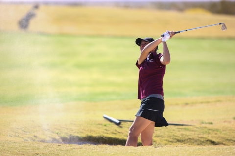 Faith Lutheran's Julia Becker hits the ball out of a bunker during the Division I-A So ...
