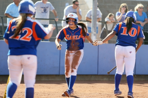Bishop Gorman's Shelby Estocado, center, celebrates with teammates Dayton Yingling, le ...
