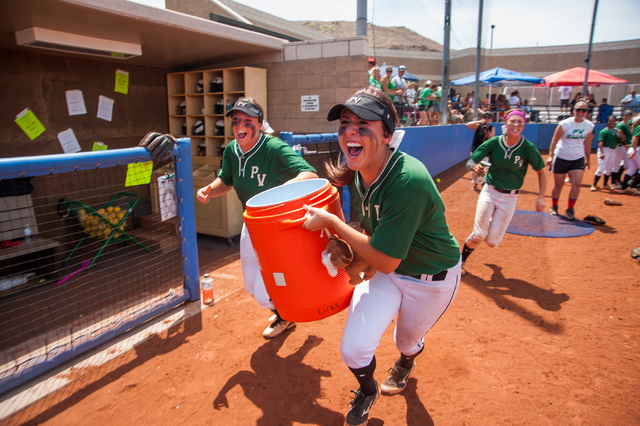 Palo Verde players Rachael Turner, left, and Rachel Williams grab a hold of the gatorade coo ...