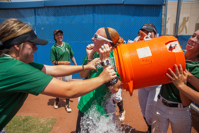 Palo Verde players give their coach Kelly Glass, center, the winning water bath after their ...