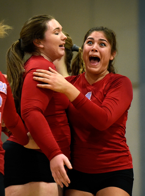 Western's Elaina Tillmond, right, and Nikki Riggs react after scoring a point against ...